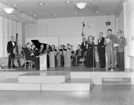 [Musicians and singers on stage for a CJOR radio broadcast]