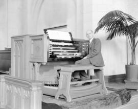 Sydney Kelland at console of organ in St. Andrew's Wesley Church [1012 Nelson Street]