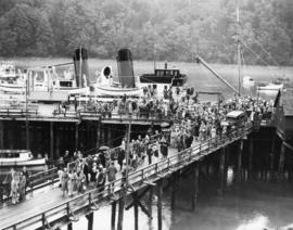 [Union Steamer passengers disembarking at Deep Bay dock]