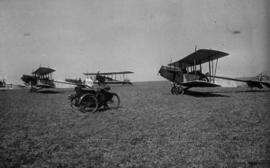 [Biplanes on a grass runway]