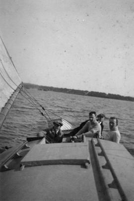 [Men on a sailboat]