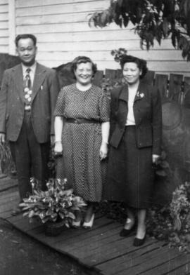 Foon Wong, Lillian Ho Wong, and Winnifred Eng in the garden at 350  East Pender Street