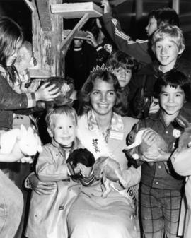Leanne Moore, Miss P.N.E. 1975, posing with children and rabbits