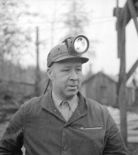 [Head and shoulders portrait of a miner]