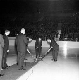 Ceremonial puck drop at Vancouver Canucks WHL hockey game in Pacific Coliseum