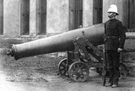 Sentry from The Duke of Connaught's Own Rifles beside cannon outside the Beatty Street Drill...