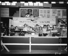 Boys with model airplanes at Hastings Prop Twisters booth in 1957 P.N.E. Hobby Show