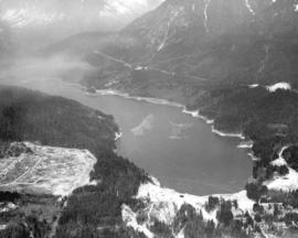 [Aerial view of the Cleveland Dam, Capilano Lake and a portion of the Glenmore subdivision]