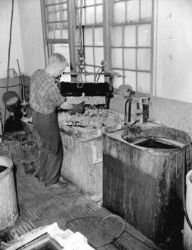 [Man at work at] Dominion Electrohome Industries