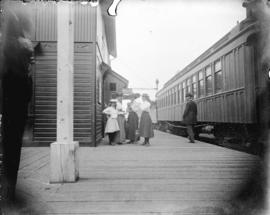 [Woman and girls assembled on platform of C.P.R. station]