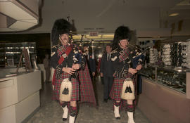 Bagpipers walking through The Bay
