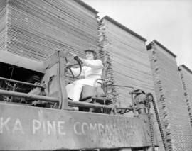 Alaska Pine [showing woman driving a truck]