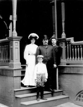 [Group portrait of a man, two women and a boy on steps of building in Plainfield, New Jersey]