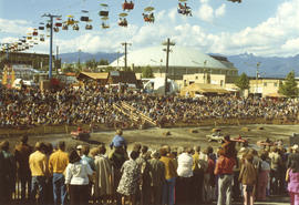 Crowd watching All-Terrain Vehicles Show, with Sky Glider chair lift overhead and Agrodome in bac...