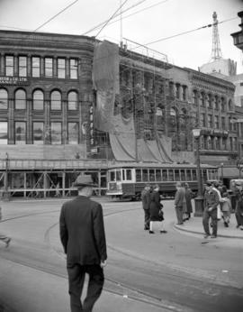 [Pedestrians and street car at Cambie and Hastings]