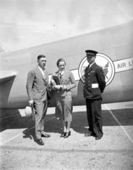 [Mr. Maclachlin, Miss Bow and Frank Way beside a United Airlines airplane]