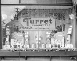 """Turret"" [advertising in] window of the [Vancouver] Sun office"