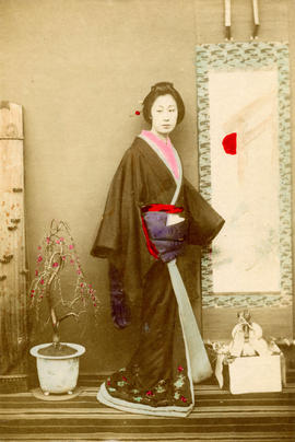 [Full-length studio portrait of woman in formal Japanese dress]