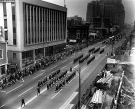 Naval cadets (?) in P.N.E. parade heading north on Burrard Street, near Pender Street