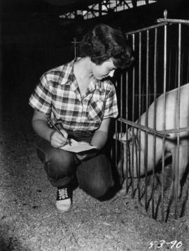 Girl with caged pig