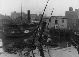 "[A capsized boat (""Ballena"") at the Union Steamship dock]"
