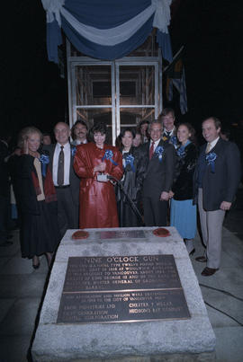 Group standing behind plaque at the first firing of the Nine O'Clock Gun