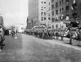 A regiment passing; general hospital motor unit in rear