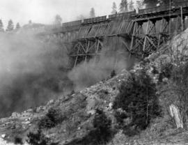 Filling Four Mile Creek trestle, mile 127.2 : The dust in the material