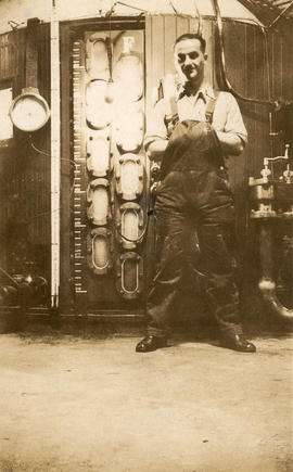 J. Perry in front of cast iron vacuum pans