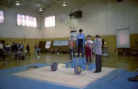 Winners on podium in gymnasium