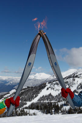 Passing of the flame in front of the mountain view from Blackcomb Mountain, BC