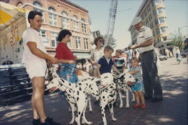 Vancouver Day attendees petting dalmatians