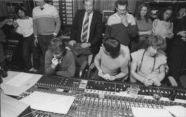 Group behind mixing boards at Griffiths Gibson Productions