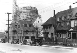 [St. James' Church, surrounded in scaffolding, with houses in the foreground]