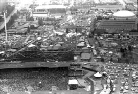 Aerial view of P.N.E. grounds and crowd at outdoor concert in Empire Stadium