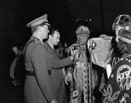 [Chief William Scow and party reading a declaration to confer an honourary chieftainship on Lord ...
