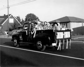 "[A truck advertising ""Live Bate"" with children riding in the box during a parade in Ker..."