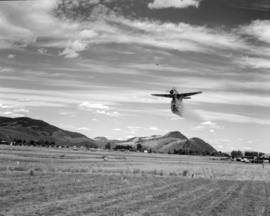 [Water bomber dropping water on a field near Kamloops]