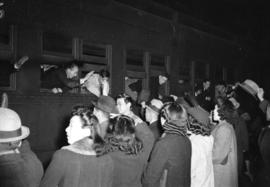 [Japanese nationals waving goodbye to evacuees at the C.P.R. Station en route to a work camp near...