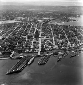 Aerial photo, oblique, CPR docks in foreground, looking south Granville Street at centre