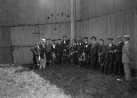 [Group beside a flagpole, Caledonian Games, Athletic Park]