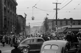 [Crowds fill the corner of Main Street and Hastings Street during VJ Day celebrations]