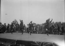Highland dancers on a stage in a competition