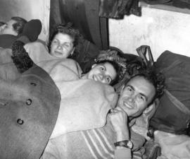 [Hungarian refugees bed down in the Immigration Building at the airport]