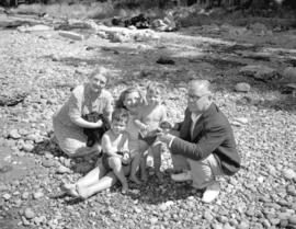 W. Harvey [and family on the beach]