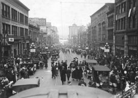 [Crowds gathered for Armistice Day on Granville Street north of Georgia Street]