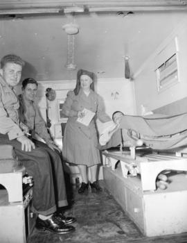 Canadian Red Cross [with returning soldiers at] Great Northern Station