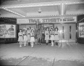 "[Cowgirls with a cowboy on a horse outside the Strand Theatre as a promotion for the movie ""..."