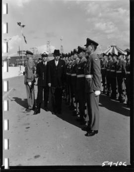 Canadian Prime Minister J.G. Diefenbaker inspects troops at Armed Forces exhibit on P.N.E. grounds