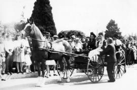 [Mrs. David Oppenheimer and Winnifred Upston in a wagon during the rededication of Stanley Park]
